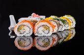 Various kind of sushi food served on black background