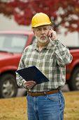 Construction Supervisor On Phone