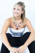 Attractive blond woman on studio