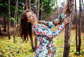 beautiful brunette woman in the autumn park