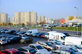 Cars On The Holding Yard And City View In Vilnius