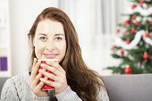 Young Girl Enjoy Hot Coffee At Christmas