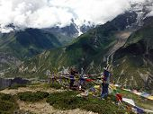 Dancing Prayer Flags In Himalayas During Monsoon
