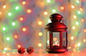 Christmas background with lantern and colorful lights