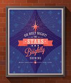 Holidays type design with christmas star and sunburst rays - Poster in wooden frame on a brick wall.