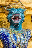 yaksha demon supporting golden chedi grand palace Bangkok Thailand