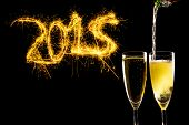 Bottle Filling Champagne Glasses For Celebrating New Years Eve 2015