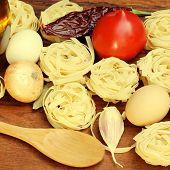 Tagliatelle Pasta Ingredients On Wooden Board