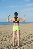 Fit, healthy woman, showing off her strong back