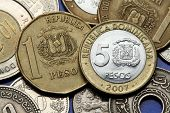 Coins of the Dominican Republic. Dominican national coat of arms depicted in the Dominican one and five peso coins.