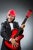 Funny guitar player in studio