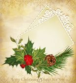 Christmas greeting with holly and a greeting card