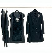 Designer fashion female autumn/winter clothing on hangers
