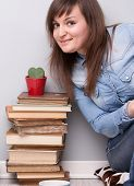 Lovely Girl Loving Her Plant And Her Books