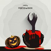 Scary smiling pumpkin with witch hand in a blood pot for Halloween party celebration concept on stylish grey background.