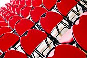 Diagonal picture of rows of red chairs