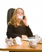 Businesswoman With Sheet Of Paper In Her Mouth