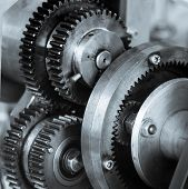 Gears and cogs of old machine close up