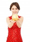 Woman Holding A Golden Piggy Bank . Happy Chinese New Year