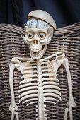 Skeleton Sitting In A Wicker Chair