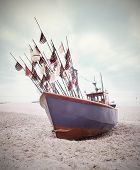 Small Fishing Boat On Shore Of The Baltic Sea, Vintage Retro Style.