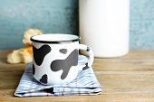 Retro still life with tasty rustic milk, on wooden table