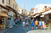 Tourists and shoppers at Rhodes old city centre shopping street