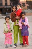 BHAKTAPUR, NEPAL, NOVEMBER 24, 2010: A group of Nepalese little girls posing in the main Bhaktapur s