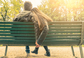 image of sitting a bench  - Couple on a bench  - JPG
