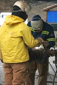 picture of tig  - Welders cut pipe with a torch during a pipeline instalation - JPG