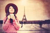 Girl Holding Cup Of Coffee On Eiffel Tower Background