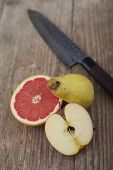 Cut Fruit On Wooden Surface With Knife