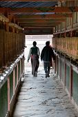 Tibetan People And Prayer Wheels, Labrang Monastery