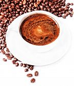 Coffee Cup And Saucer With  Roasted Coffee Beans Isolated On A White Background, Close Up.