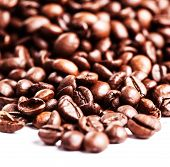 Brown Coffee Beans  Isolated On White Background. Roasted Coffee Beans For Background And Texture. C