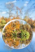 Glass sphere with autumn nature reflection