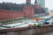 The Flowers Near A Place Of Murder Of The Politician Boris Nemtsov And The Car Of Police Protecting