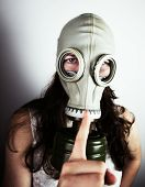 Woman wearing gas mask close-up