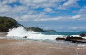 stock photo of na  - Waves crash onto Lumahai beach with Na Pali range in background on Kauai Hawaii - JPG