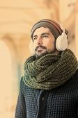 Portrait Of Bearded Man With Headphones In Instagram Tones