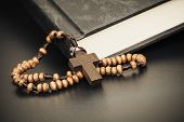 stock photo of friday  - Christian cross necklace on Holy Bible book Jesus religion concept as good friday or easter festival - JPG