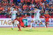Sisaket Thailand-february 18: Tatree Seeha Of Sisaket Fc. (orange) In Action During Thai Premier Lea