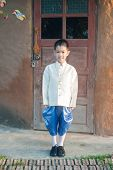 picture of character traits  - Asian lovely boy wearing national dress - JPG