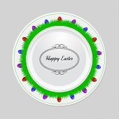 Decorative easter plate on gray background, top view