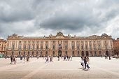Tourists And Locals Pay A Visit To The Capitole De Toulouse