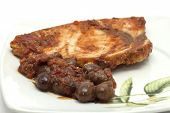 stock photo of swordfish  - recipe from restaurant swordfish in sauce with olives served on a plate