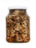 Appetizing Tinned Mushrooms In Glass Jar.isolated.