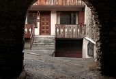 Arched View Of Old House With Wooden Balcony,bormio, Italy
