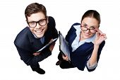 Top view photo of business man and woman with folders