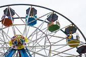 stock photo of ferris-wheel  - Ferris wheel cars fun fair ride on the sea front at Scarborough UK for vactations and holidays - JPG